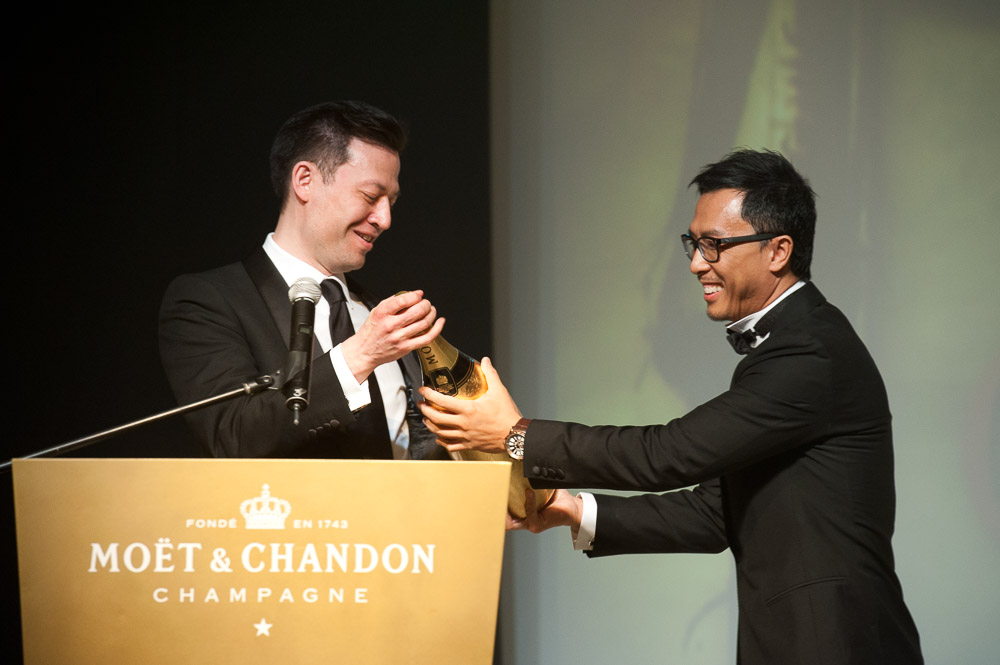 Donnie Yen 甄子丹 handing moet & chandon champagne to the host.