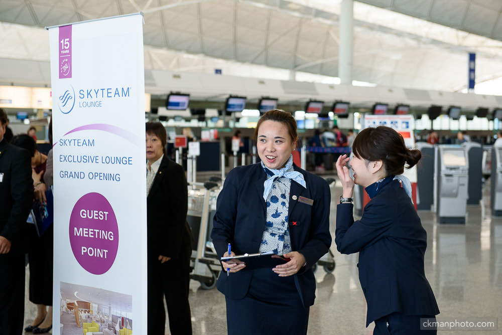 Skyteam exclusive lounge grand opening guest meeting point served by ground staff in Hong Kong International Airport departure hall