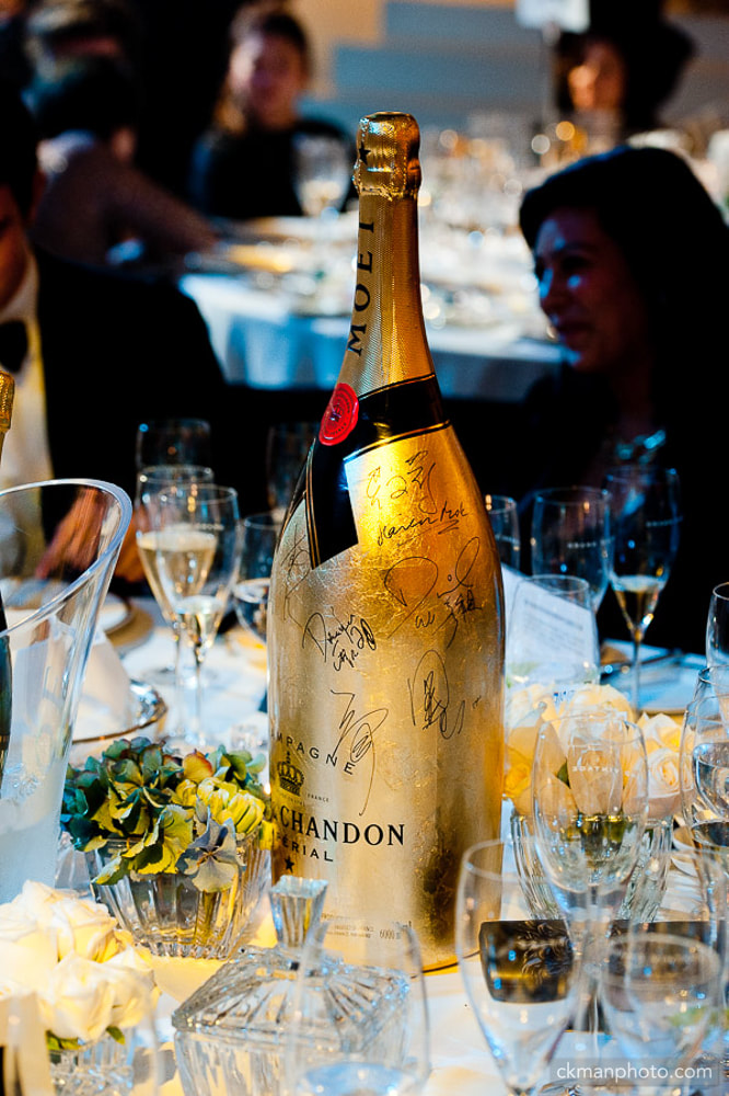 Celebrities autographs on a champagne