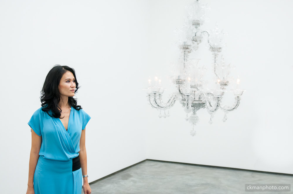 chandelier and lady in blue dress