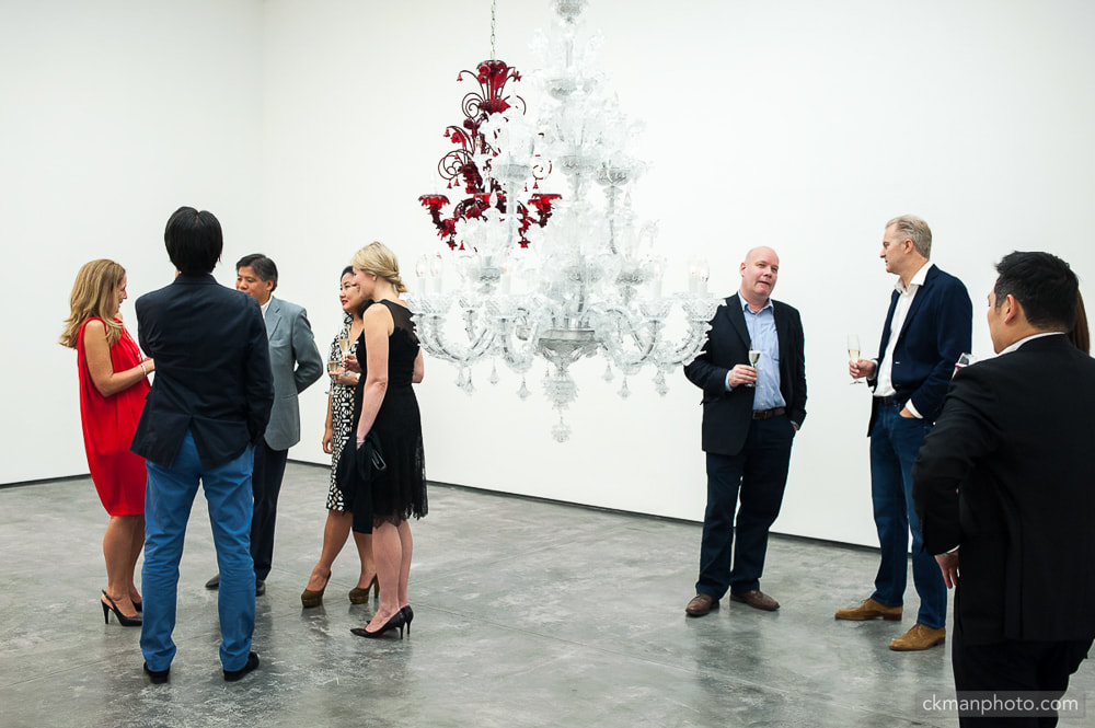 White Cube Gallery VIPs mingling. chandelier in the gallery